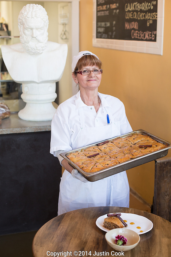 Olga holds a tray of Baklava at Kipos in Chapel Hill, N.C. on Thursday, March 13, 2014. (Justin Cook)