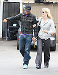 .6-10-09.Laura Dern walking with Ben Harper after eating lunch at Harvest restaurant in Los Angeles ca .Ben was wearing some bright blue shoes..AbilityFilms@yahoo.com.805-427-3519.www.AbilityFilms.com