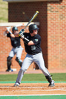 Kyle Jackson (19) of the Coastal Carolina Chanticleers at bat against the High Point Panthers at Willard Stadium on March 15, 2014 in High Point, North Carolina.  The Chanticleers defeated the Panthers 1-0 in the first game of a double-header.  (Brian Westerholt/Four Seam Images)