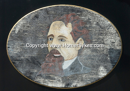 Charles Dickens faded weather beaten oil portrait outside the  pub in village of   kent UK.