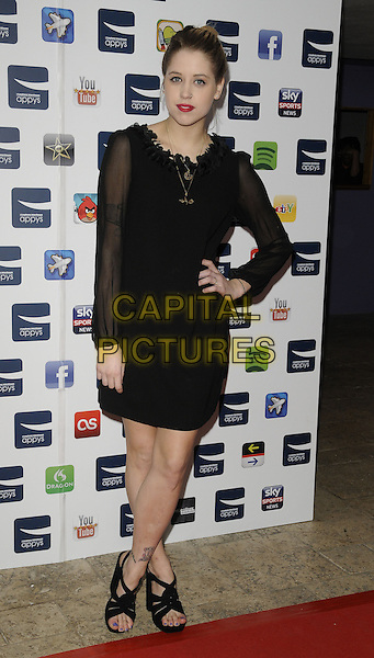 PEACHES GELDOF <br /> At the Carphone Warehouse Appys Awards, Vinopolis, Stoney Street, London, England, UK, April 11th 2011.<br /> full length black dress hand on hip sheer sleeve see thru through  ruffle neck necklace sandals open toe tattoo <br /> CAP/CAN<br /> &copy;Can Nguyen/Capital Pictures