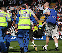 Darren McGregor being stretchered off in the St Mirren v Hibernian Clydesdale Bank Scottish Premier League match played at St Mirren Park, Paisley on 18.8.12.