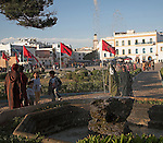 Gardens and red Moroccan flag Place Moulay Hassan, Essaouira, Morocco