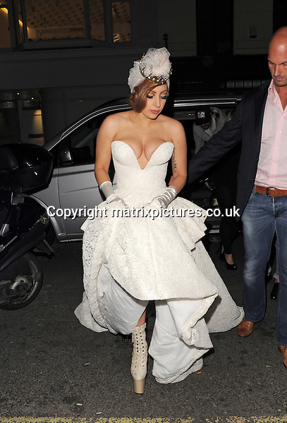 NON EXCLUSIVE PICTURE: MATRIXPICTURES.CO.UK.PLEASE CREDIT ALL USES..WORLD RIGHTS..American pop singer Lady Gaga is pictured wearing a very revealing wedding dress when returning to central London's Dorchester Hotel...SEPTEMBER 9th 2012..REF: LTN 123732