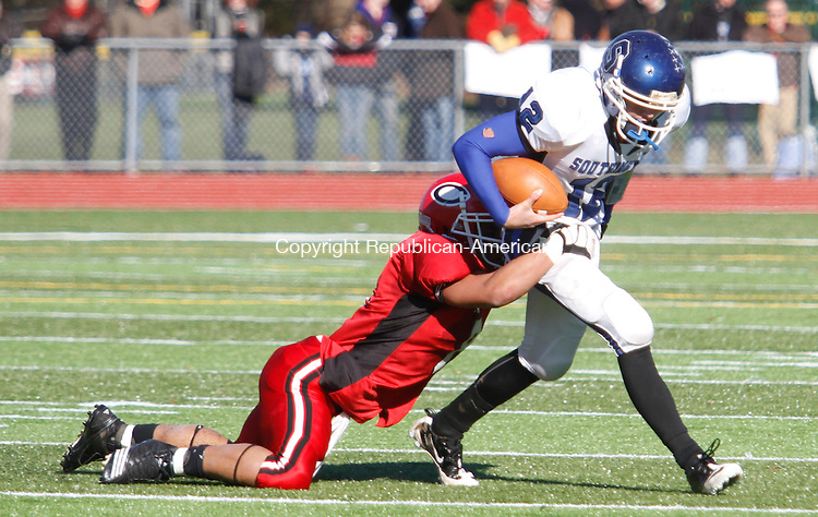 CHESHIRE,  CT.- 24 NOVEMBER 2011-112411JW09-  Cheshire # 8 Sebastian Little takes down  Southington #12Stephen Barmore during the Thanksgiving Day game at Cheshire.<br /> Jonathan Wilcox Republican American