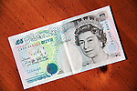 Five pound British currency note on table