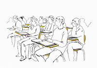 Group of students sitting at desks listening.ExclusiveImage