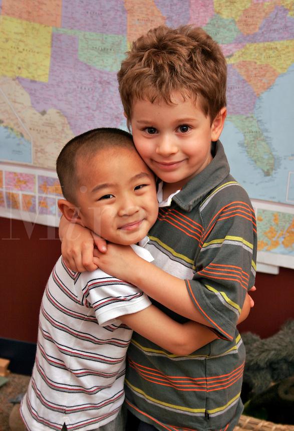 Kindergarten students hugging.