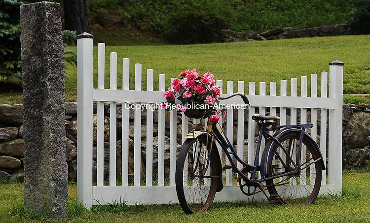 ROXBURY, CT-05AUGUST 2012--080512JS12-FOR COUNTRY LIFE USE ONLY-A decorative flower arrangement sits in a basket of an old bicycle at a home on Rucum Road in Roxbury. ..Jim Shannon Republican-American