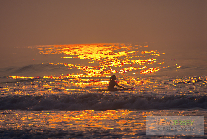 Surfer, anticipating the incoming waves, Avalon, New Jersey
