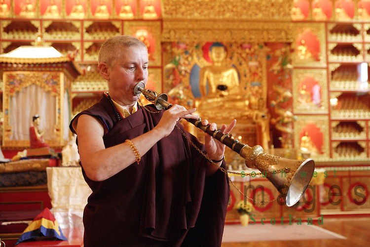 Samye Ling Monastry and Tibetan Centre Eskdalemuir near Langolm Dumfries and Galloway elaborate decoration inside temple nun playing the Jaling