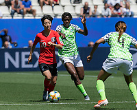 GRENOBLE, FRANCE - JUNE 12: Hyeri Kim #20 of the Korean National Team dribbles at midfield as Asisat Oshoala #8 of the Nigerian National Team pressures during a game between Korea Republic and Nigeria at Stade des Alpes on June 12, 2019 in Grenoble, France.
