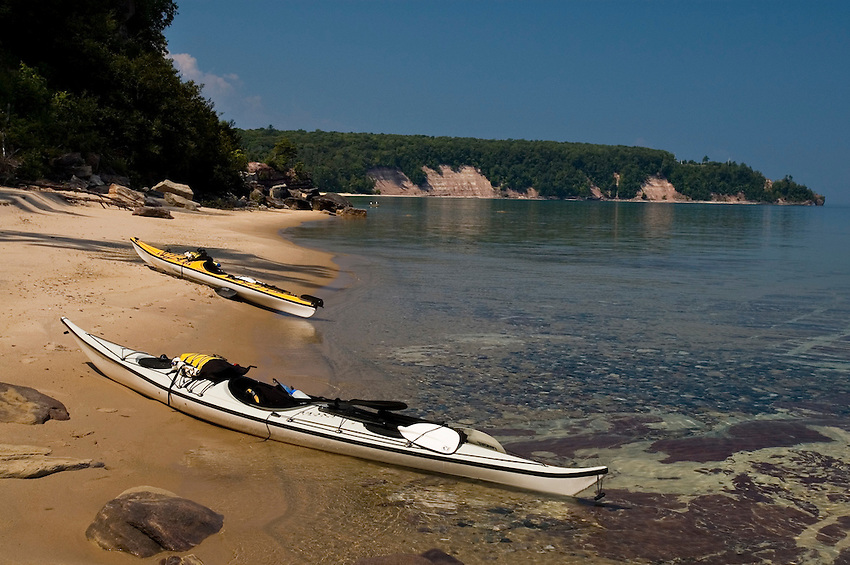 A pair of sea kayaks beached at Grand Island National Recreation Area in Munising Michigan.