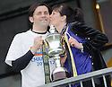 Alloa manager Paul Hartley gets a kiss from his mum, Ann, after lifting the 3rd division trophy.