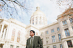 Dr. Jorge Simmonds-Diaz stands outside the Georgia Capitol building in Atlanta, Georgia December 3, 2012. Hundreds of health care workers in Georgia are losing their medical licenses because a new state immigration law requires everyone to prove their citizenshop or legal residency.