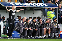 Millwall Caretaker Manager, Adam Barrett shows his emotions while standing alongside the Leeds dug-out during Millwall vs Leeds United, Sky Bet EFL Championship Football at The Den on 5th October 2019