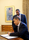 Washington, DC - May 7, 2009 -- UNited States President Barack Obama signs the proclamation marking the National Day of Prayer on Thursday, May 7, 2009.  Looking on is Joshua DuBois, Director of the White House Office for Faith-Based and Neighborhood Partnerships..Mandatory Credit: Pete Souza - White House via CNP