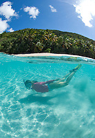 Split level snorkeler<br /> Little Cinnamon Bay.<br /> Virgin Islands National Park.<br /> St John USVI