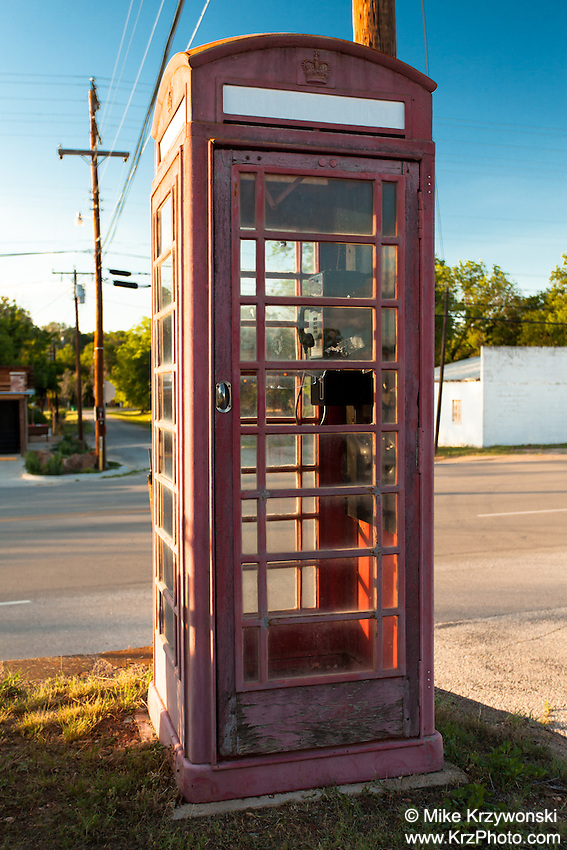 "Old British ""Red Telephone Box"" payphone booth in Palo Pinto, TX"