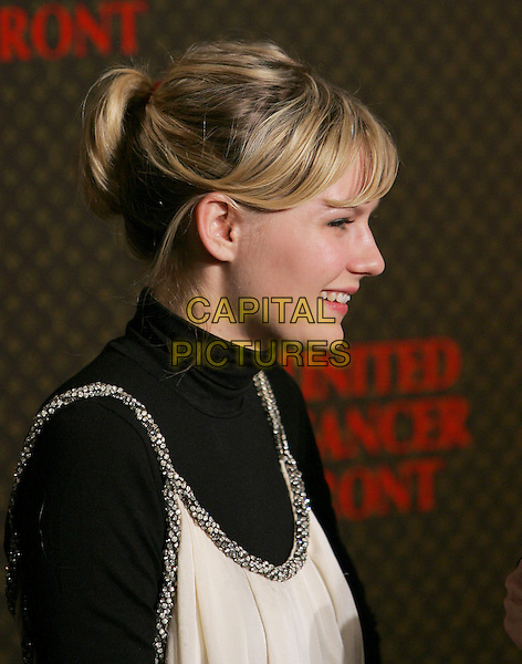 KIRSTEN DUNST.The 2nd Annual Louis Vuitton United Cancer Front Gala held at Universal Studios, Stage 24 in Universal City, California .November 8th, 2004.headshot, portrait, profile.www.capitalpictures.com.sales@capitalpictures.com.©Debbie Van Story/Capital Pictures