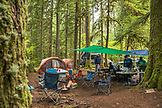 USA, Oregon, Santiam River, Brown Cannon, young boys eating breakfast in a campground near the Santiam River in the Willamete National Forest