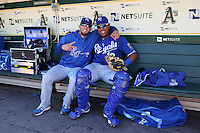 OAKLAND, CA - MAY 19:  James Shields #33 and Salvador Perez #13 of the Kansas City Royals pose for a picture in the dugout before the game against the Oakland Athletics at O.co Coliseum on Sunday May 19, 2013 in Oakland, California. Photo by Brad Mangin