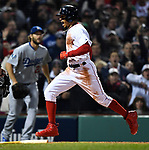 BOSTON, MA - OCTOBER 23: Mookie Betts #50 of the Boston Red Sox scores in front of Clayton Kershaw #22 of the Los Angeles Dodgers during the first inning of Game One of Major League Baseball's World Series at Fenway Park in Boston, Massachusetts on October 23, 2018. (Staff photo by Christopher Evans)
