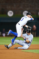 Glendale Desert Dogs Tim Locastro (3), of the Los Angeles Dodgers organization, jumps over Grayson Greiner (15) sliding into second base after making the throw to first during a game against the Salt River Rafters on October 19, 2016 at Camelback Ranch in Glendale, Arizona.  Salt River defeated Glendale 4-2.  (Mike Janes/Four Seam Images)
