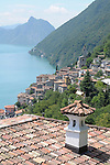 A view of Lake Lugano and the mountain San Salvatore; view from Castello, a town in the mountains on Lake Lugano, Italy.