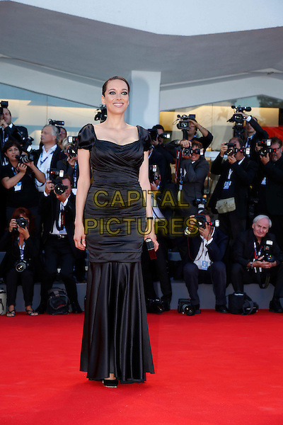 Carmen Chaplin.The Opening Ceremony of the 69th Venice International Film Festival at Palazzo del Cinema, Venice, Italy. .August 29th, 2012 .full length black dress drop waist photographers press .CAP/IPP/GR.©Gianluca Rona/IPP/Capital Pictures.