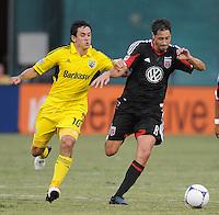D.C. United midfielder Branko Boskovic (8) goes against Columbus Crew midfielder Milovan Mirosevic (10)  D.C. United defeated The Columbus Crew 1-0 at RFK Stadium, Saturday August 4, 2012.