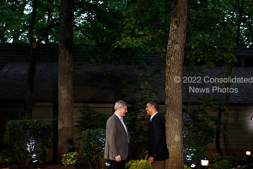 United States President Barack Obama greets Canadian Prime Minister Stephen Harper in front of Laurel Lodge at Camp David during the 2012 G8 Summit on Friday, May 18, 2012 in Camp David, Maryland. Leaders of eight of the worlds largest economies meet over the weekend in an effort to keep the lingering European debt crisis from spinning out of control.  .Credit: Luke Sharrett / The New York Times / Pool via CNP