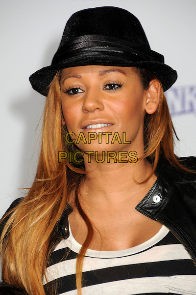 "MELANIE BROWN aka MEL B.""Justin Bieber: Never Say Never"" Los Angeles Premiere held at Nokia Theater L.A. Live, Los Angeles, California, USA..February 8th, 2011.headshot portrait black hat striped top grey gray leather fedora.CAP/ADM/BP.©Byron Purvis/AdMedia/Capital Pictures."