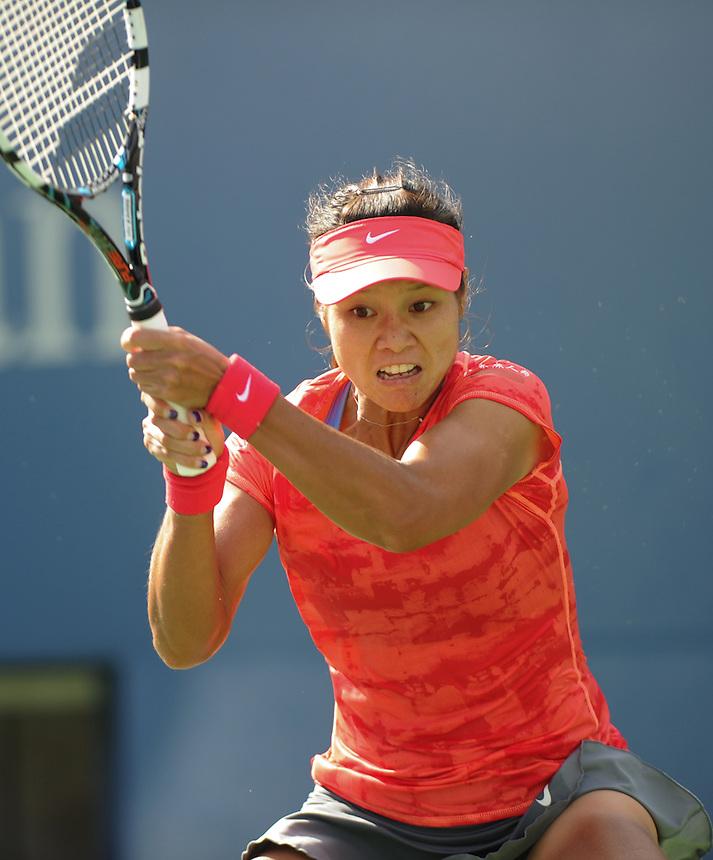 Na Li (CHN) in action during her victory over Ekaterina Makarova (RUS) in their Women's Singles - Quarterfinal match today - Na Li (CHN) [5] def. Ekaterina Makarova (RUS) [24] 6-4 6-7(5) 6-2<br /> <br /> Photo by Gillian Elliott / CameraSport<br /> <br /> Tennis - US Open - Day 9 Tuesday 3rd September 2013 - USTA Billie Jean King National Tennis Center<br /> New York City, New York, United States<br /> <br /> &copy; CameraSport - 43 Linden Ave. Countesthorpe. Leicester. England. LE8 5PG - Tel: +44 (0) 116 277 4147 - admin@camerasport.com - www.camerasport.com
