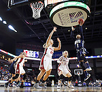 SIOUX FALLS, SD - MARCH 7:  Margaret McCloud #30 and Nicole Seekamp #35 of South Dakota defend the layup attempt by Kaylan Mayberry #1 of Oral Roberts in the 2016 Summit League Tournament. (Photo by Dick Carlson/Inertia)