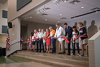 NWA Democrat-Gazette/BEN GOFF @NWABENGOFF<br /> Students join members of the Bentonvill School Board and principals in a ribbon cutting Friday, Aug. 11, 2017, during a grand opening for Osage Creek Elementary School and Creekside Middle School in Bentonville. The new schools will welcome their first students Monday.