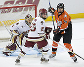 Brian O'Hanley 23 of Boston College guards against Kai Kantola 14 of Bowling Green in front of Cory Schneider 1 of Boston College. The Eagles of Boston College defeated the Falcons of Bowling Green State University 5-1 on Saturday, October 21, 2006, at Kelley Rink of Conte Forum in Chestnut Hill, Massachusetts.<br />