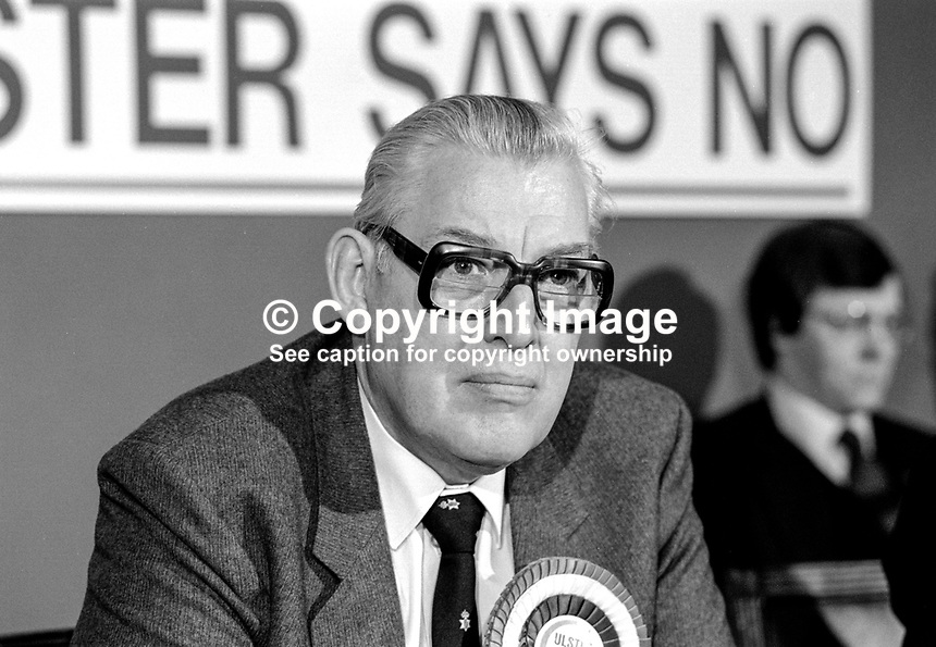Rev Ian Paisley, Democratic Unionist, candidate, UK Parliamentary by-elections, January 1986. He was one of 15 sitting Unionist MPs, Official, Democratic & Popular, who resigned in protest at the signing of the Anglo-Irish Agreement. As a result of the exercise one unionist seat was lost to the SDLP. Taken at joint Press Conference announcing the mass resignation of unionist MPs. 19860113IP2..Copyright Image from Victor Patterson, 54 Dorchester Park, Belfast, United Kingdom, UK...For my Terms and Conditions of Use go to http://www.victorpatterson.com/Victor_Patterson/Terms_%26_Conditions.html