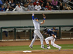 Reno Aces' Nick Ahmed beats an errant throw to Las Vegas 51s' first baseman Allan Dykstra, in Reno, Nev., on Saturday, Sept. 6, 2014. The Aces won 7-3, to win the Pacific Conference Championship Series. <br /> Photo by Cathleen Allison