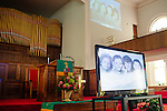 A historical video plays in the sanctuary of 16th Street Baptist Church during a tour in downtown Birmingham, Alabama. In 1963, four girls were killed when a bomb under the church's side steps went off.