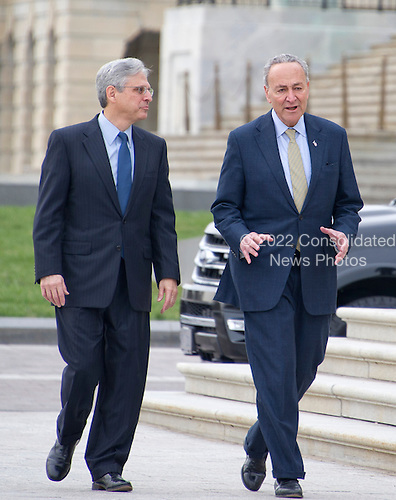 United States Senator Chuck Schumer (Democrat of New York), right, leads Judge Merrick Garland, chief justice for the US Court of Appeals for the District of Columbia Circuit, who is US President Barack Obama's selection to replace the late Associate Justice Antonin Scalia on the US Supreme Court, left, to a photo op at the US Capitol in Washington, DC on Tuesday, March 22, 2016.   <br /> Credit: Ron Sachs / CNP<br /> (RESTRICTION: NO New York or New Jersey Newspapers or newspapers within a 75 mile radius of New York City)