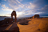 THE AMPHITHEATER SURROUNDING DELICATE ARCH AT SUNSET AT ARCHES NATIONAL PARK, UTAH