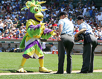 August 9, 2009:  Mascot BirdZirk! performs with a dancer dressed as an umpire along with third base umpire Toby Basner assists during a game at Wrigley Field in Chicago, IL.  Iowa is the Pacific Coast League Triple-A affiliate of the Chicago Cubs.  Photo By Mike Janes/Four Seam Images