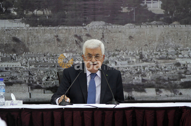 President Mahmoud Abbas meets with Palestinian leadership, at Abbas's headquarter in the West Bank city of Ramallah, on October 1, 2014. Abbas said that he will reevaluate the Palestinian Authority's ties with Israel if the UN Security Council does not pass a planned resolution that would set a timetable for ending Israel's occupation of the West Bank and establish an independent Palestinian state on the 1967 borders. Photo by Shadi Hatem