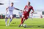 S&ouml;dert&auml;lje 2015-08-01 Fotboll Superettan Assyriska FF - &Ouml;stersunds FK :  <br /> &Ouml;stersunds Dragan Kapcevic i kamp om bollen med Assyriskas Andreas Haddad under matchen mellan Assyriska FF och &Ouml;stersunds FK <br /> (Foto: Kenta J&ouml;nsson) Nyckelord:  Assyriska AFF S&ouml;dert&auml;lje Fotbollsarena Superettan &Ouml;stersund &Ouml;FK