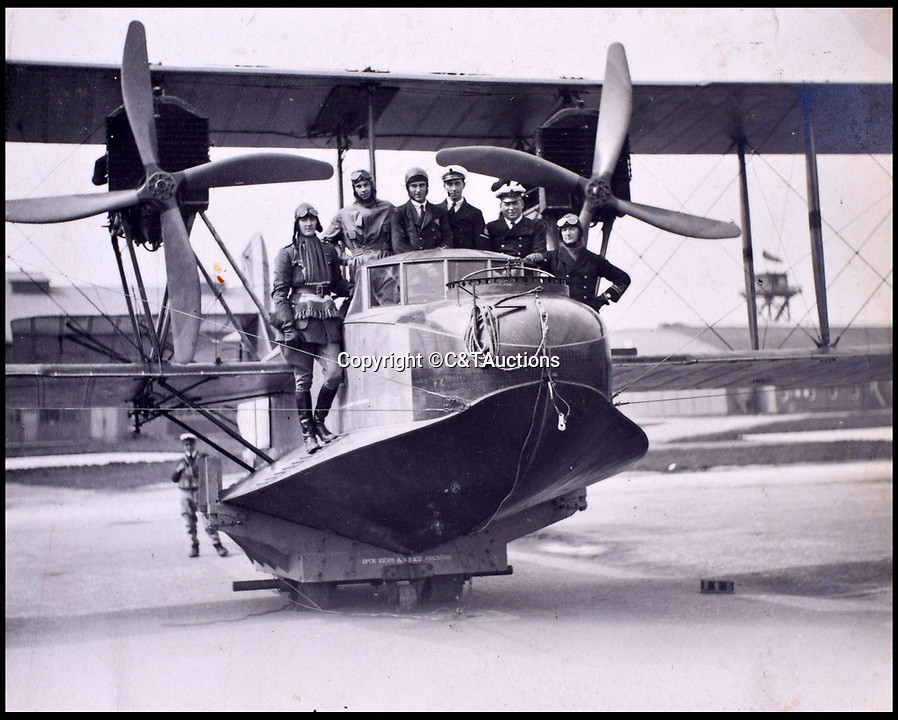 BNPS.co.uk (01202 558833)<br /> Pic: C&TAuctions/BNPS<br /> <br /> RNAS crews pose for a picture on a huge Felixstowe flying boat from the first war.<br /> <br /> A fascinating photo album which documents the adventures of a captain in the fledgling Royal Naval Air Service has been unearthed after 100 years.<br /> <br /> The photos were compiled by Captain Denis Carey who was based in Maidstone, Kent, and they provide a fascinating insight into the air arm of the Royal Navy during the First World War.<br /> <br /> They show the thrills and spills of the pioneering early days of aviation in a world before health and safety had been invented.