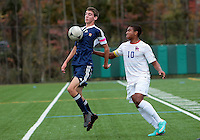 HYATTSVILLE, MD - OCTOBER 26, 2012:  Sean Cowdrey (10) of DeMatha Catholic High School defends against Nate Johnson (19) of St. Albans during a match at Heurich Field in Hyattsville, MD. on October 26. DeMatha won 2-0.