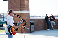 Super Bulldog Weekend: Baseball vs Arkansas at Dudy Noble Field.  Jeffrey Rupp playing guitar before game.<br />  (photo by Megan Bean / &copy; Mississippi State University)