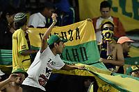 BOGOTÁ -COLOMBIA, 15-04-2017. Hinchas del Bucaramanga durante el encuentro entre Independiente Santa Fe y Atletico Bucaramanga partido por la fecha 13 de la Liga Aguila I 2017 jugado en el estadio Nemesio Camacho El Campin de la ciudad de Bogota. / Fans of Bucaramanga cheer for their team during match between Independiente Santa Fe and Atletico Bucaramanga for the date 13 of the Aguila League I 2017 played at the Nemesio Camacho El Campin Stadium in Bogota city. Photo: VizzorImage/ Gabriel Aponte / Staff
