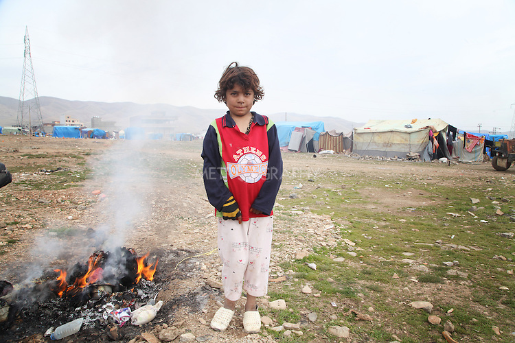 ARBAT, IRAQ: Hader Tallal, 7, from Derzor, Syria, is pictured in a refugee camp in Arbat, Iraq. ..The semi-autonomous region of Iraqi Kurdistan has accepted refugees from the conflict in Syria into several camps. Arbat lies near Sulaimaniyah in northeastern Iraq, approximately 500 kilometres from the Syrian border...Photo by Besaran Tofiq/Metrography